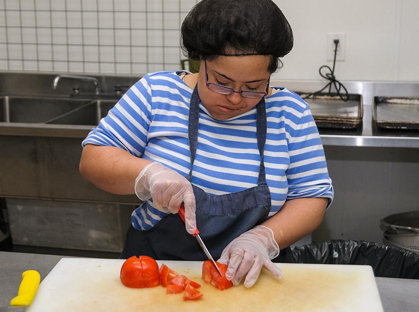 woman chopping vegatibles