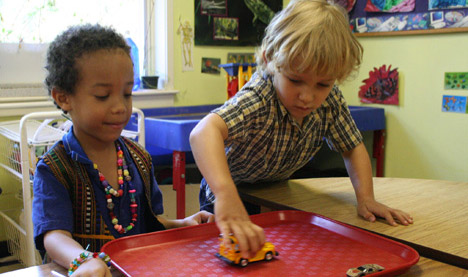 Photo of two children playing together in a class